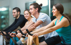 Group young  working out of cycling in fitness club Stock Photo