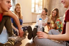 Group of youngsters pausing from dancing training Stock Images