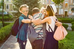 Group of youth is having fun, happy teenagers friends walking, talking enjoying day in the city. royalty free stock images