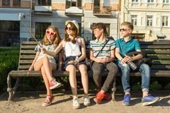 Group of youth is having fun together outdoors in urban background. Summer holidays, education, teenage concept. Group of youth is having fun together outdoors royalty free stock image