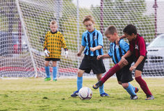 A Group of Youth Soccer Players Compete. Las Vegas, Nevada - October 18: A Summerlin park on October 18, 2014, in Las Vegas, Nevada. A Group of American Youth Royalty Free Stock Image