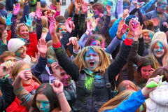 The group of youth strews itself with paints at A festival of paints. September 29,2013. Gatchina, Leningrad region, Russia. Stock Photo