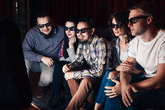 Group of youth watching new movie royalty free stock images