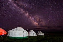 Group of yurts against the starry sky at night in the desert Royalty Free Stock Photography