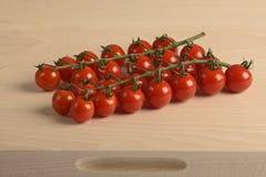 Groupe avec de petites tomates Images stock