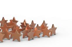 Groupe d'étoiles d'en cuivre d'isolement sur le fond blanc Photos libres de droits