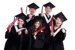 Groupe d'étudiant de diplômés heureux Images stock