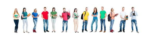 Groupe d'étudiants adolescents d'isolement sur le blanc Image libre de droits