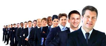 Groupe d'affaires dans une rangée d'isolement Photographie stock