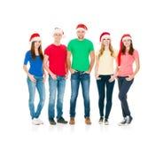 Groupe d'amis de sourire dans des chapeaux de Noël Photo libre de droits