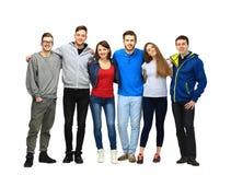 Groupe d'amis de sourire restant ensemble Image stock