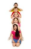 Enfants de billet de cinq livres dans une ligne Photographie stock libre de droits