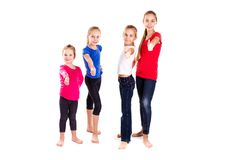 Groupe d'enfants heureux avec des pouces  Photographie stock