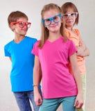 Groupe d'enfants mignons avec des lunettes Image stock