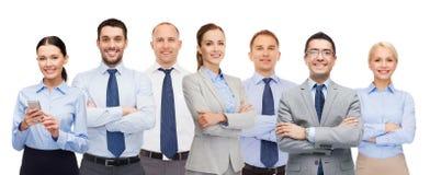 Groupe d'hommes d'affaires heureux avec les bras croisés Photos stock