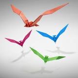 Groupe d'oiseaux de vol dans l'origami Photographie stock libre de droits
