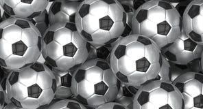 Groupe de ballons de football métalliques Image stock
