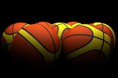 Groupe de basket-balls dans la faible lumière Photos stock