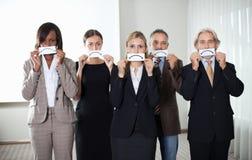Groupe de cadres d'affaires avec des émotions tristes Image libre de droits