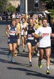 Groupe de coureurs sur la route Image libre de droits