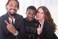 Groupe de deux Africains et d'une fille caucasienne Images stock