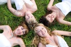 Groupe de femme de quatre mariées Photo libre de droits