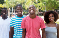 Groupe de femme et d'homme riants de l'afro-américain quatre Images libres de droits