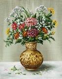 Groupe de fleurs dans un vase africain Images stock