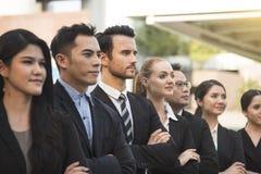 Groupe de gens d'affaires avec l'homme d'affaires pour la direction Photographie stock libre de droits