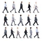 Groupe de gens d'affaires marchant dans une direction Images stock