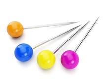 Groupe de goupilles colorées. Photographie stock libre de droits