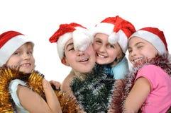 Groupe d'amis heureux célébrant Noël Image stock