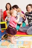 Groupe de mères avec leurs bébés Images stock