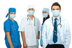 Groupe de médecins avec des masques Images libres de droits