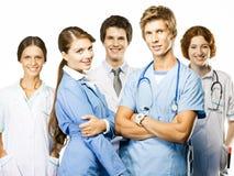 Groupe de médecins de sourire sur le fond blanc photographie stock