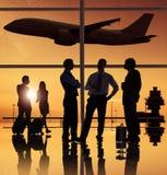 Groupe de personnes dans l'aéroport Photographie stock
