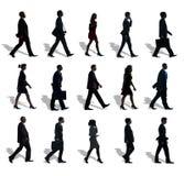 Groupe de personnes de silhouette dans une rangée Photo stock