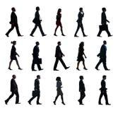 Groupe de personnes de silhouette dans une rangée Photographie stock