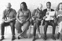 Groupe de personnes divers technologie Sittin d'unité de la Communauté photos libres de droits