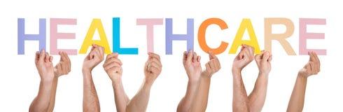 Groupe de personnes mains tenant des soins de santé des textes Photographie stock