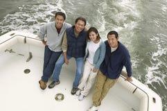 Groupe de quatre amis sur le bateau Images libres de droits