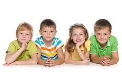 Groupe de quatre enfants gais Photographie stock libre de droits