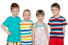 Groupe de quatre enfants joyeux Image libre de droits