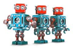 Groupe de rétros robots D'isolement Contient le chemin de coupure illustration libre de droits