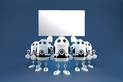 Groupe de robots avec le conseil vide Contient le chemin de coupure Images stock