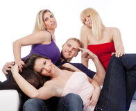 Groupe de sourire de quatre amis Photos stock