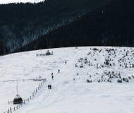 Groupe de touristes dans la neige Image stock