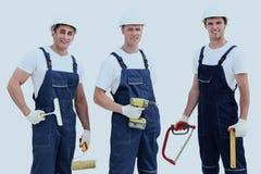 Groupe de travailleurs industriels professionnels D'isolement au-dessus du blanc photo stock