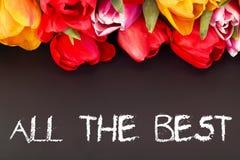 Groupe de tulipes avec le tableau noir : tout le meilleur Image stock