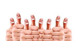 Groupe de visages de doigt en tant que réseau social photographie stock
